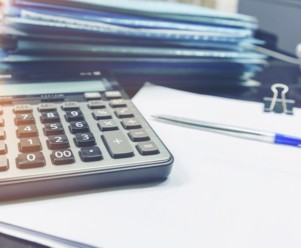 a calculator on top of an earnings statement